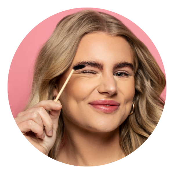 Blond girl winks with brow brush